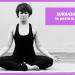 chica yogui haciendo SUKHASANA la postura fácil